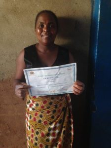 Mayi Angela with certificate of completion of Phase 2 ECD Training small